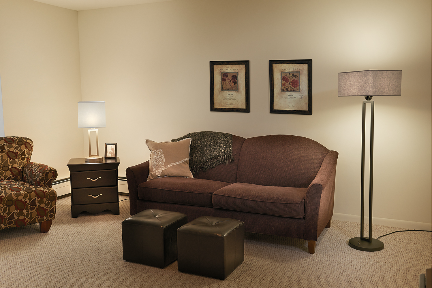Allegro portable luminaires for senior living and multifamily design provide a soft, glowing light over a living room.