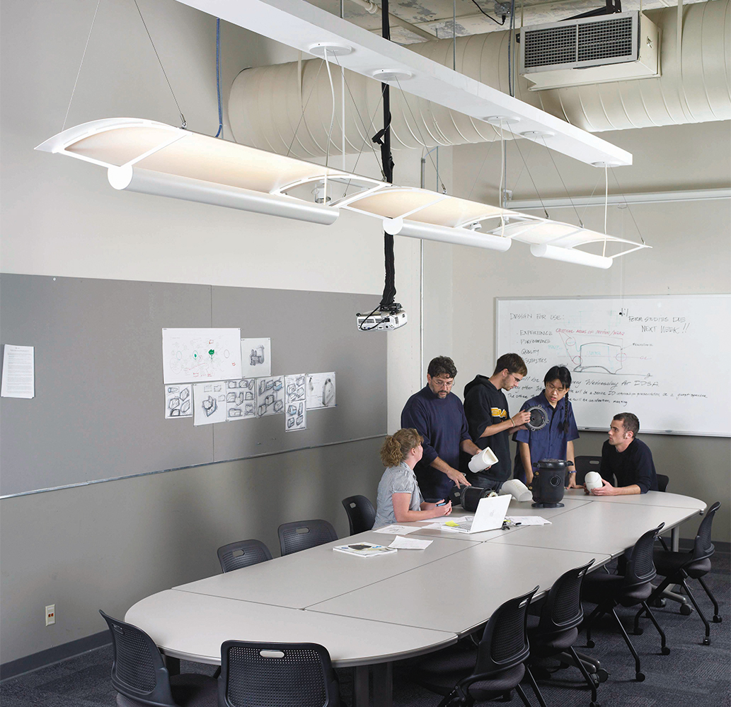 Ascent classroom lighting linear pendants provide pleasing indirect light over a classroom table.