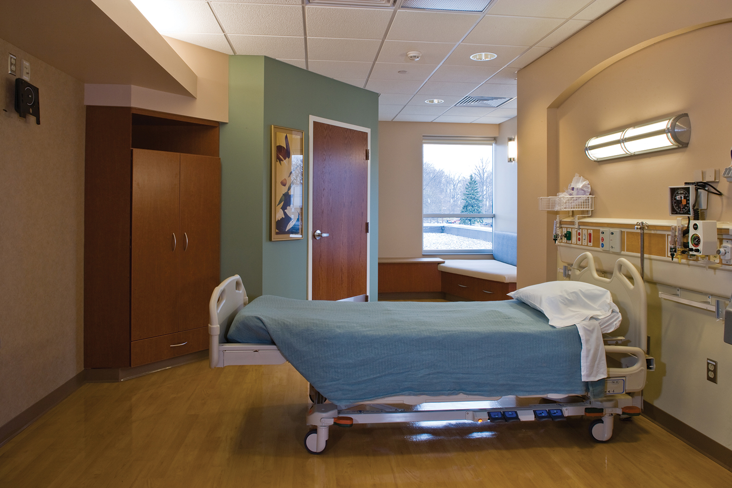 Avatar wall mounted fixture as a headwall in a patient room for sophisticated hospital lighting design.