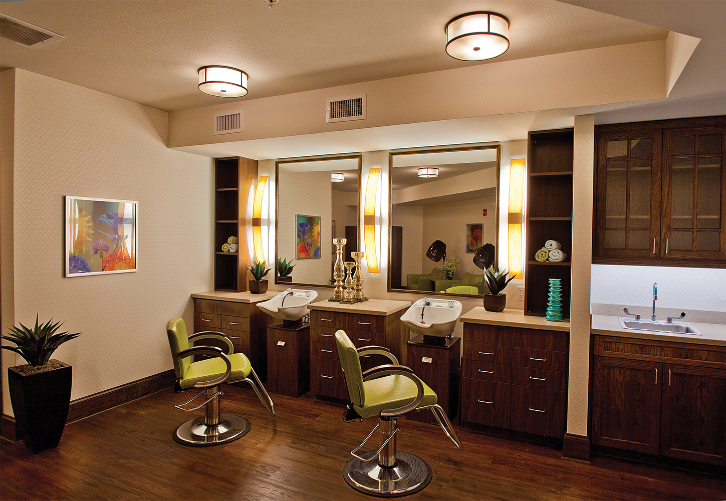 Bowe as a pleasing modern vanity light fixture, mounted vertically between salon mirrors, with Capitol ceiling luminaires.