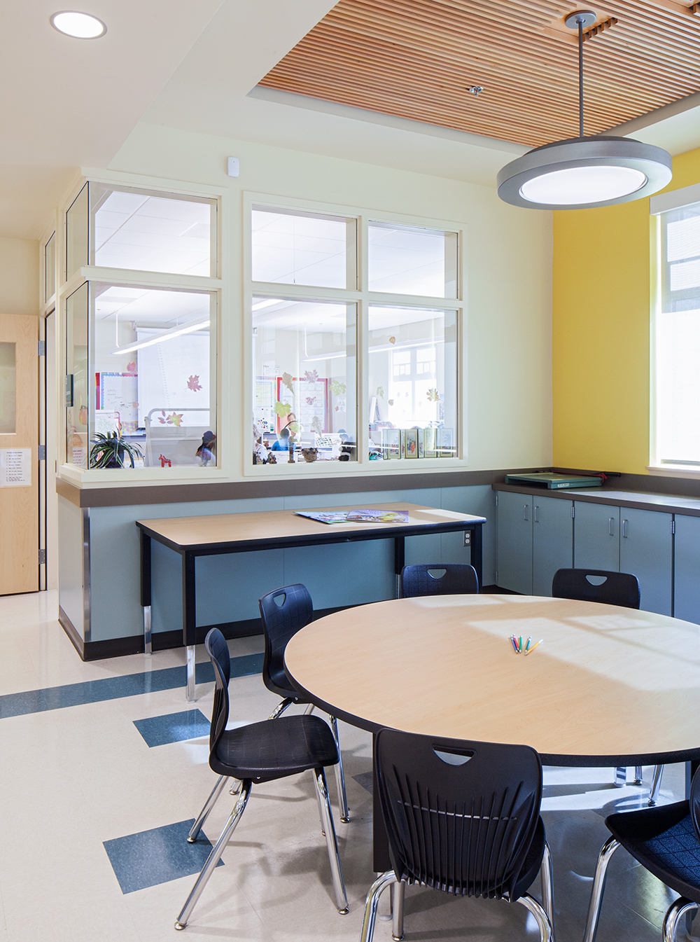 Broadway pendants in an education lighting design, seen here above a classroom table.