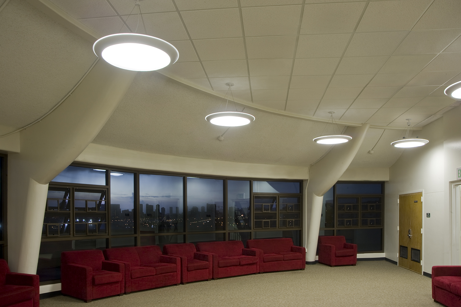 Capience pendants provide modern light for educational interior design inside a campus dormitory.