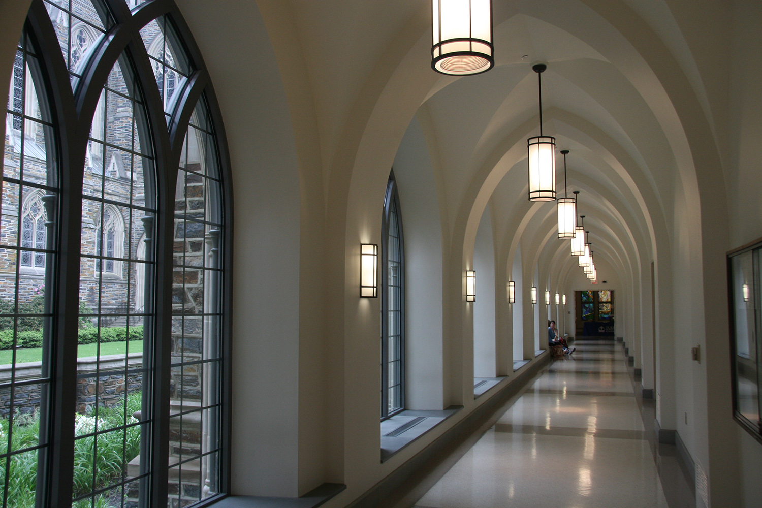 Colonnade and Cylinder complement one another in education lighting designs, seen here along a regal campus hallway.