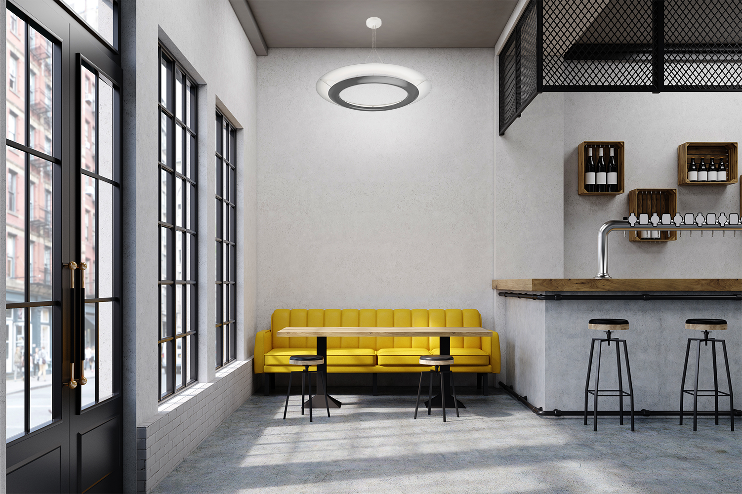 Cosmo ring pendants are perfect for commercial lighting applications, seen here above a yellow couch in a modern bar
