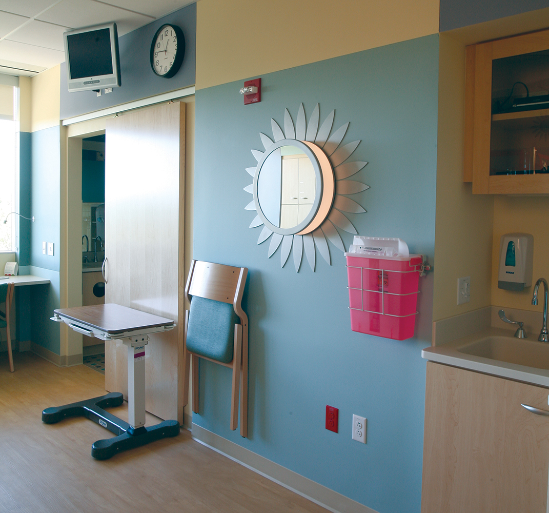 These custom light fixtures were tailored in a sunflower shape and center mirror to light up this children's hospital patient room.