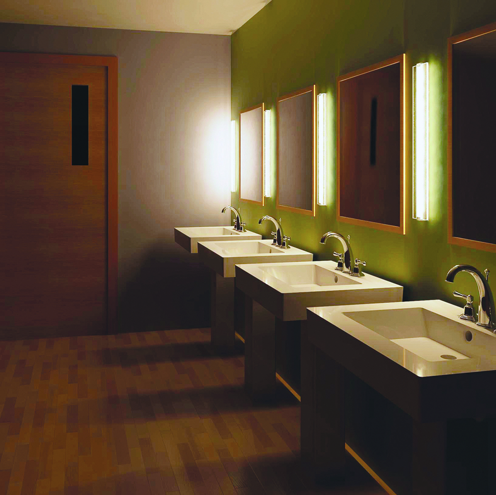 Deck as a vanity light fixture, mounted vertically between mirrors in a public restroom