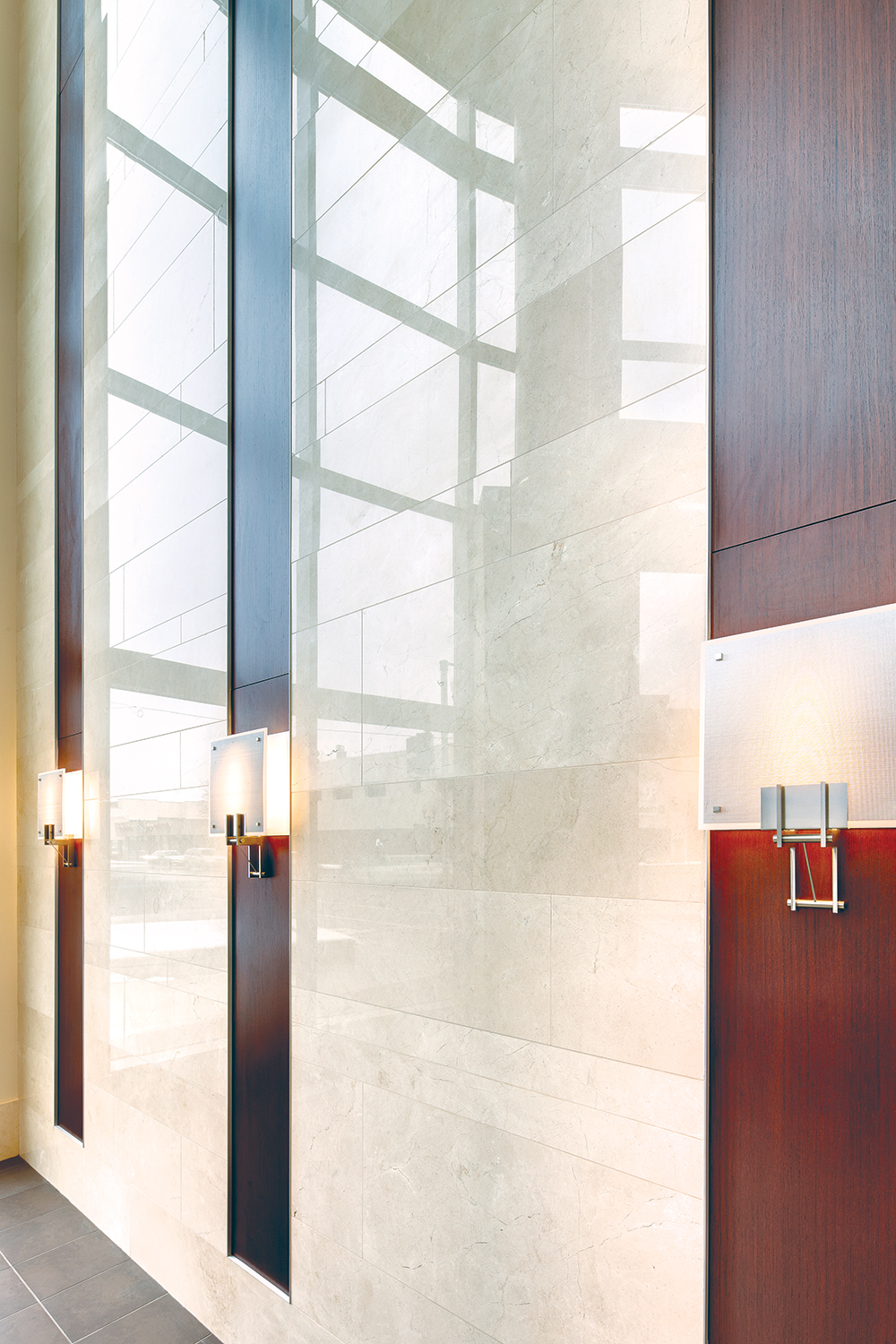 Easel wall sconces in the sleek entryway of a modern healthcare design application.
