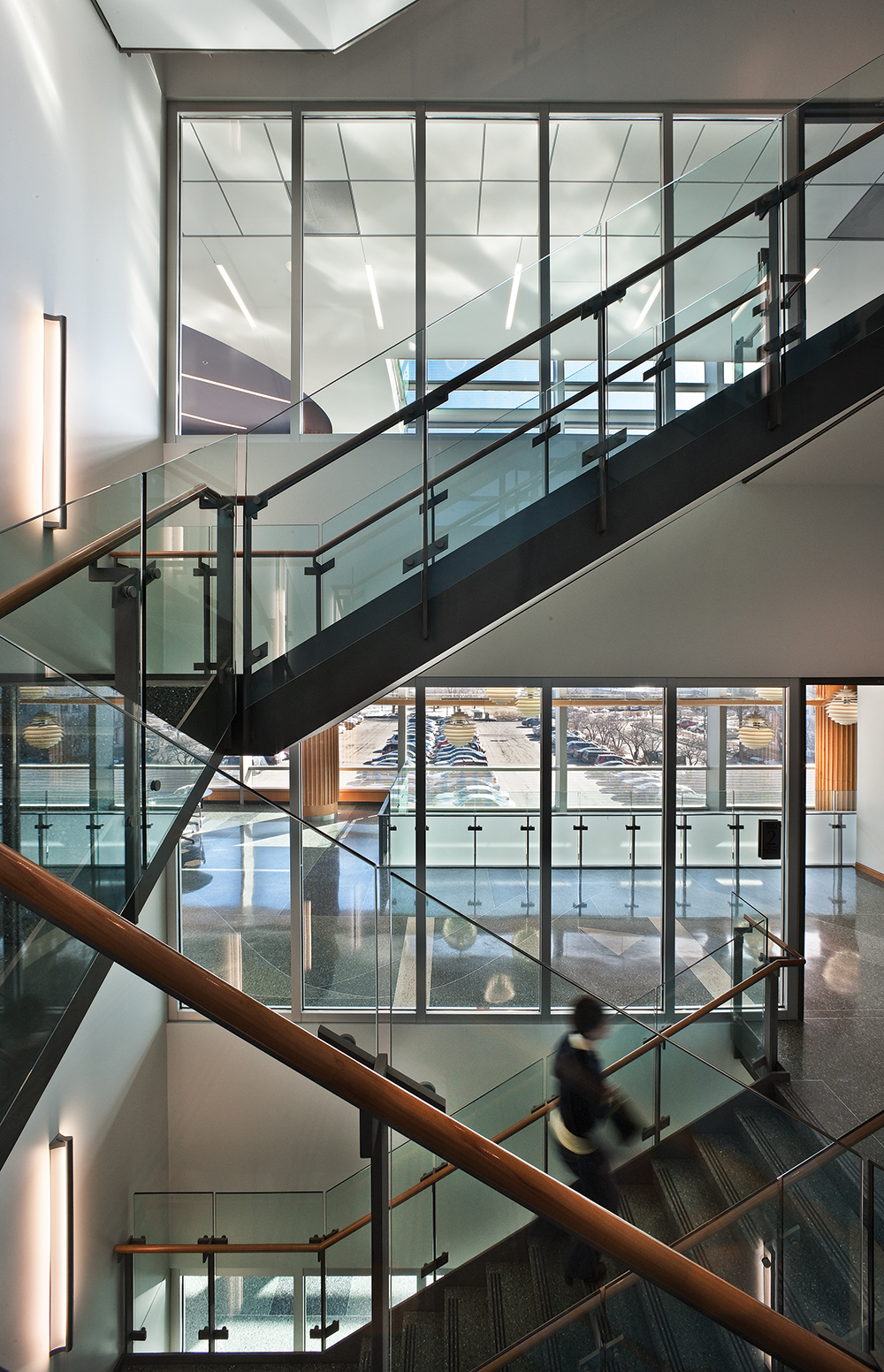 Ether linear sconces are perfect for education lighting applications, seen here in a modern campus stairwell.