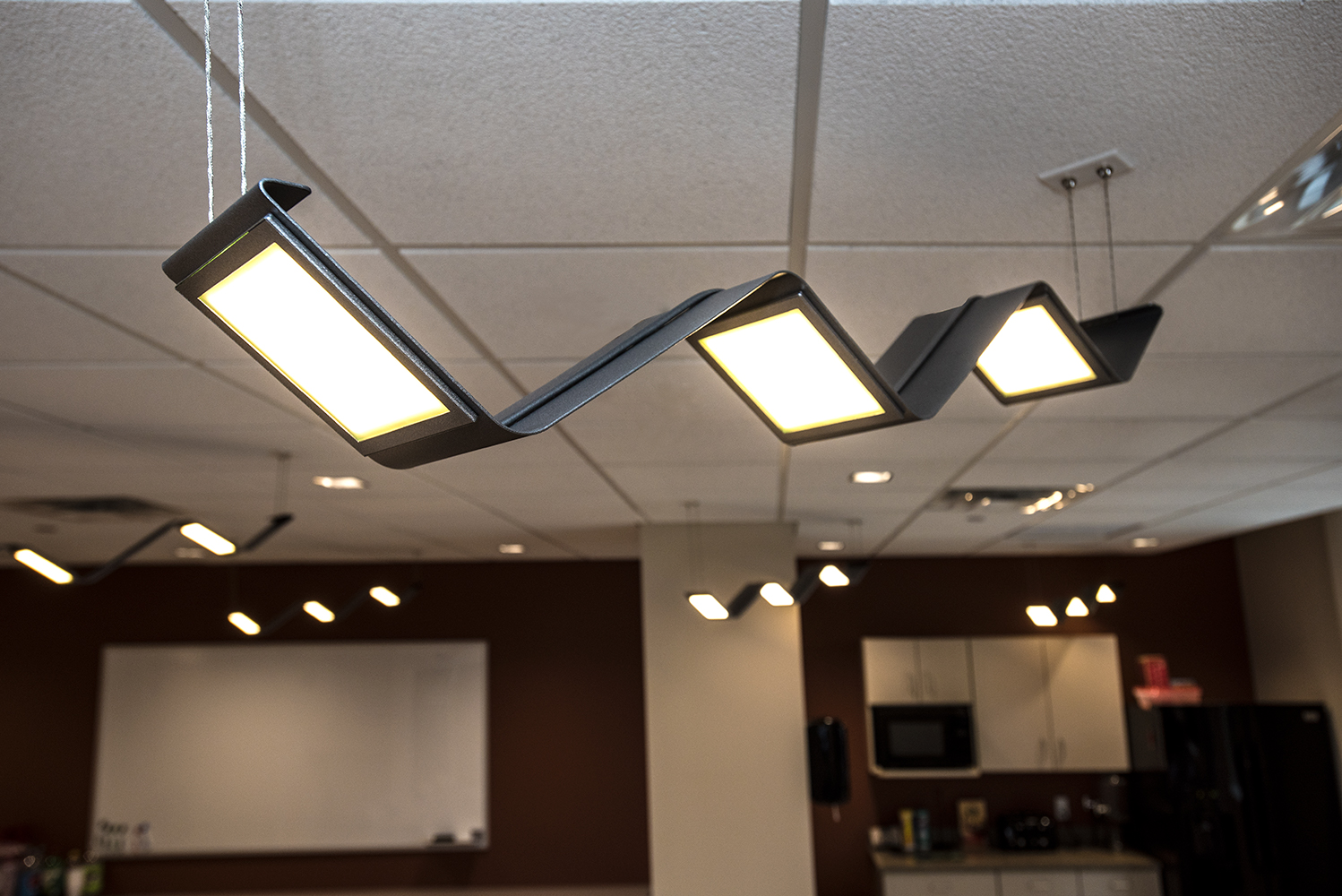 Limit pendants in a modern office lighting design.