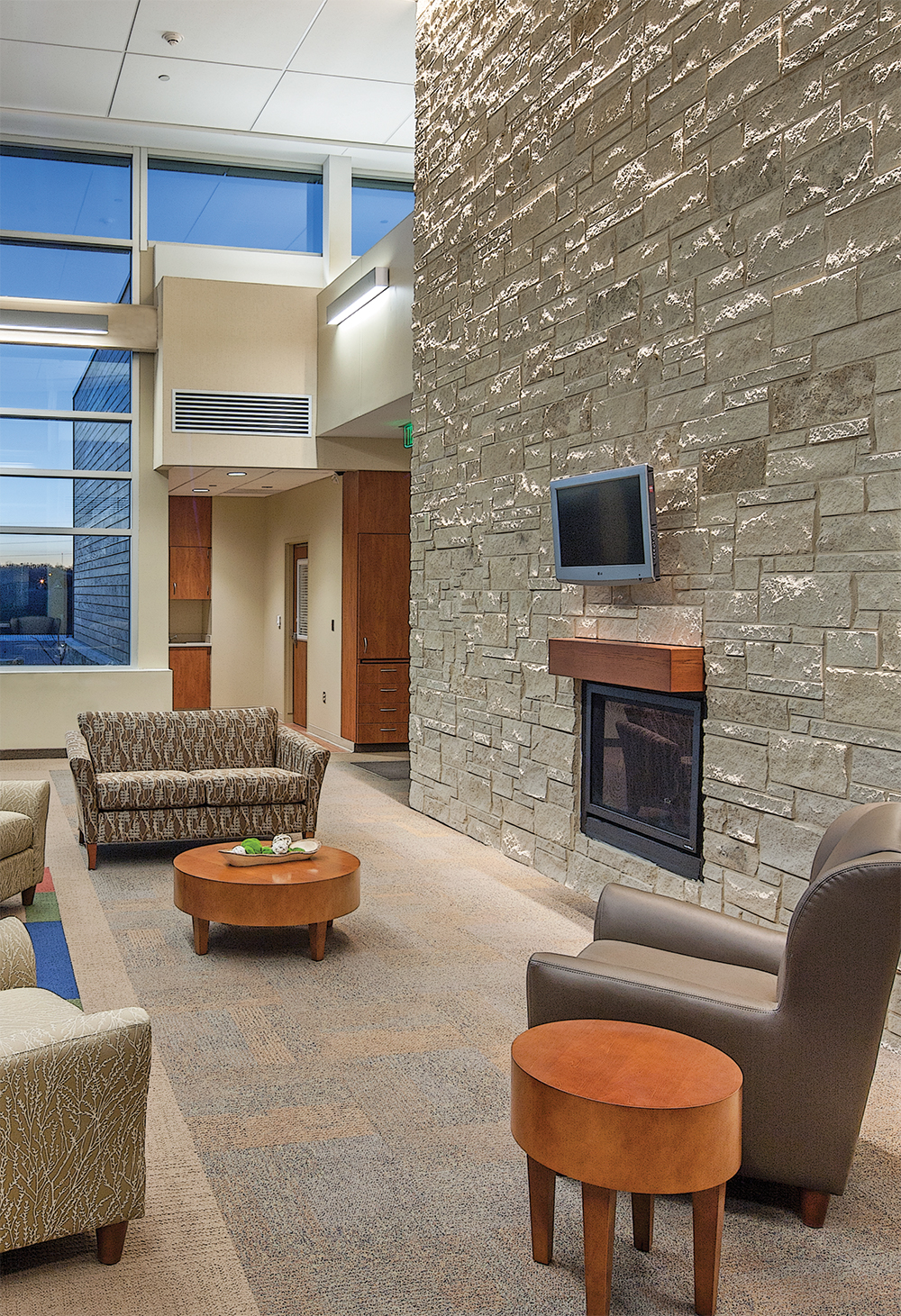 Linear Art Sconce is perfect for healthcare design applications, seen here above a hospital waiting area.