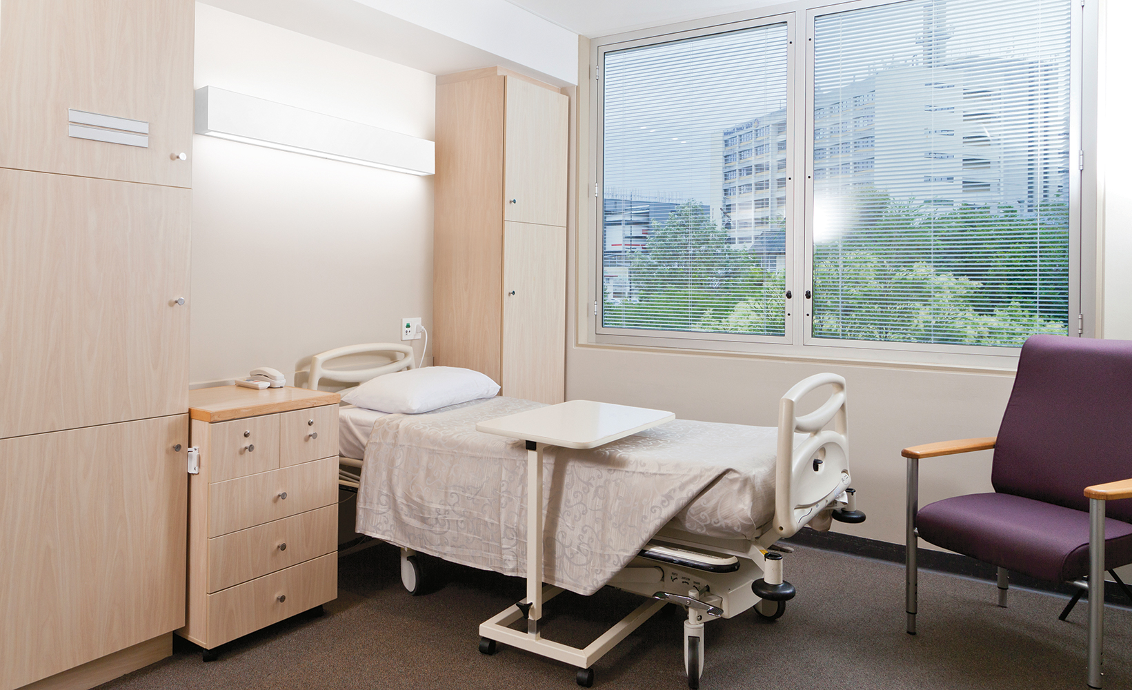 Linear Art Sconce as patient room lighting, mounted horizontally above the patient bed overlooking a large window.