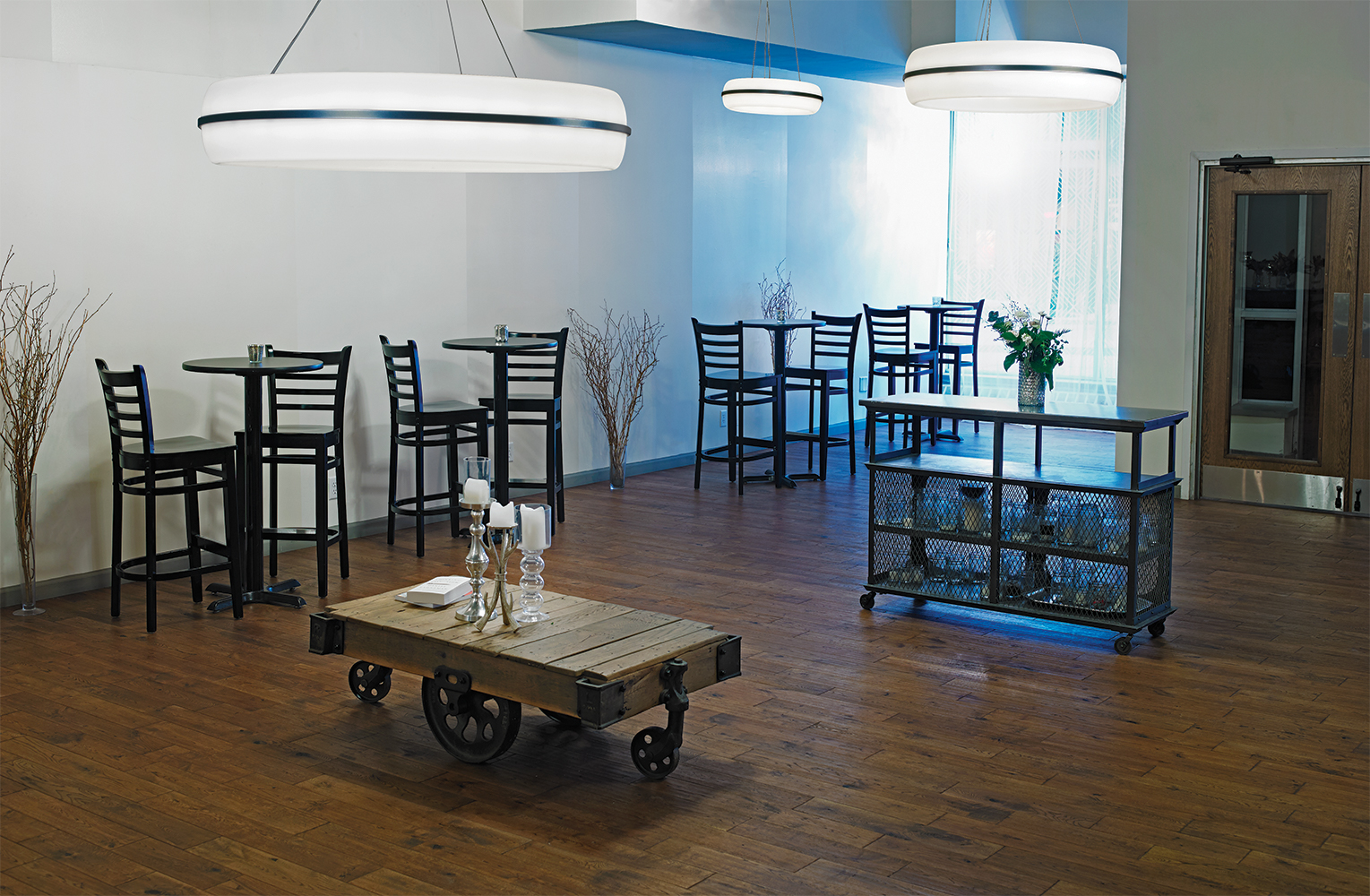 Meridian Round pendant is perfect for hospitality lighting, seen here above a small, modern café.
