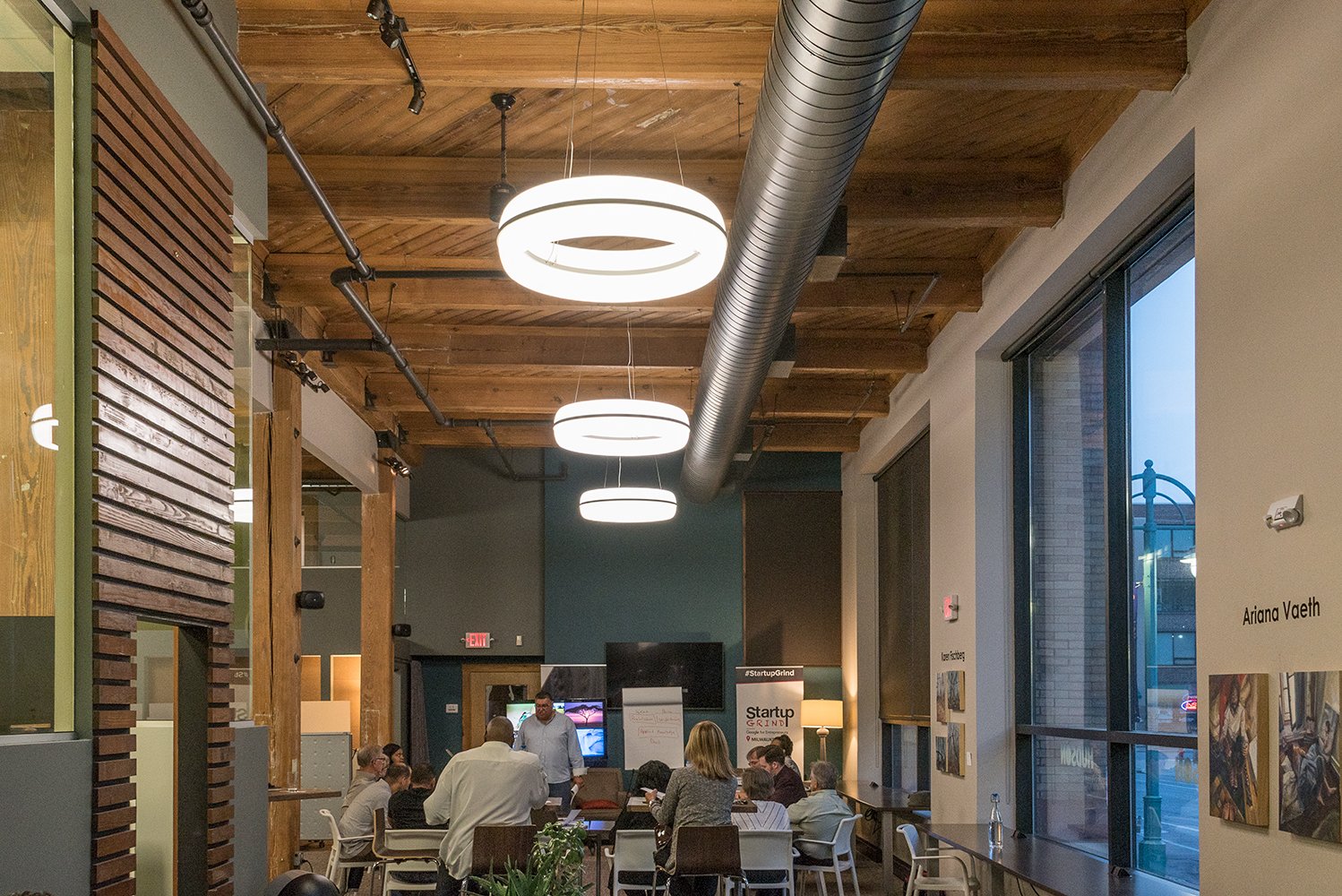 Meridian Round pendant is perfect for office lighting, seen here above a casual café area in a large office building.