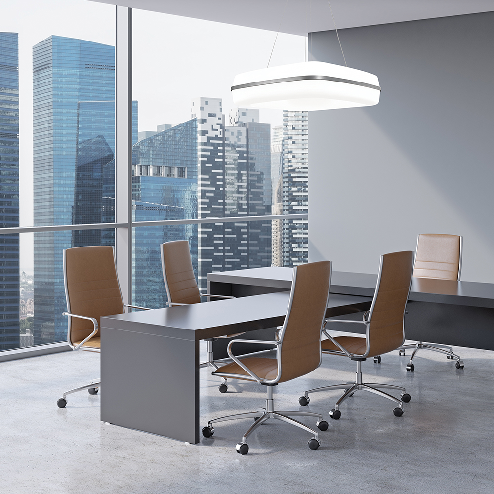 Meridian Square pendant in an office lighting design above a conference room with a large window showing a city skyline.