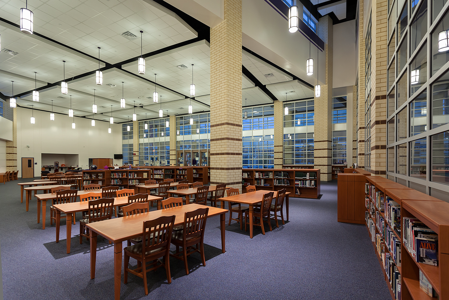 Midland Arts timeless cylindrical pendants above an education lighting application in a campus library.