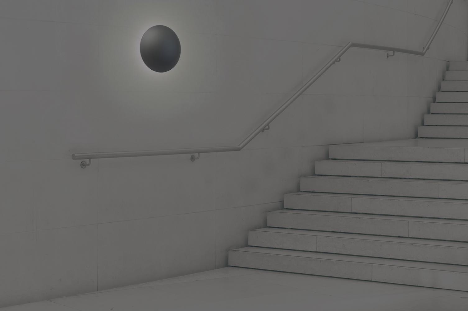 Northridge outdoor light fixture illuminating a modern exterior stairway.