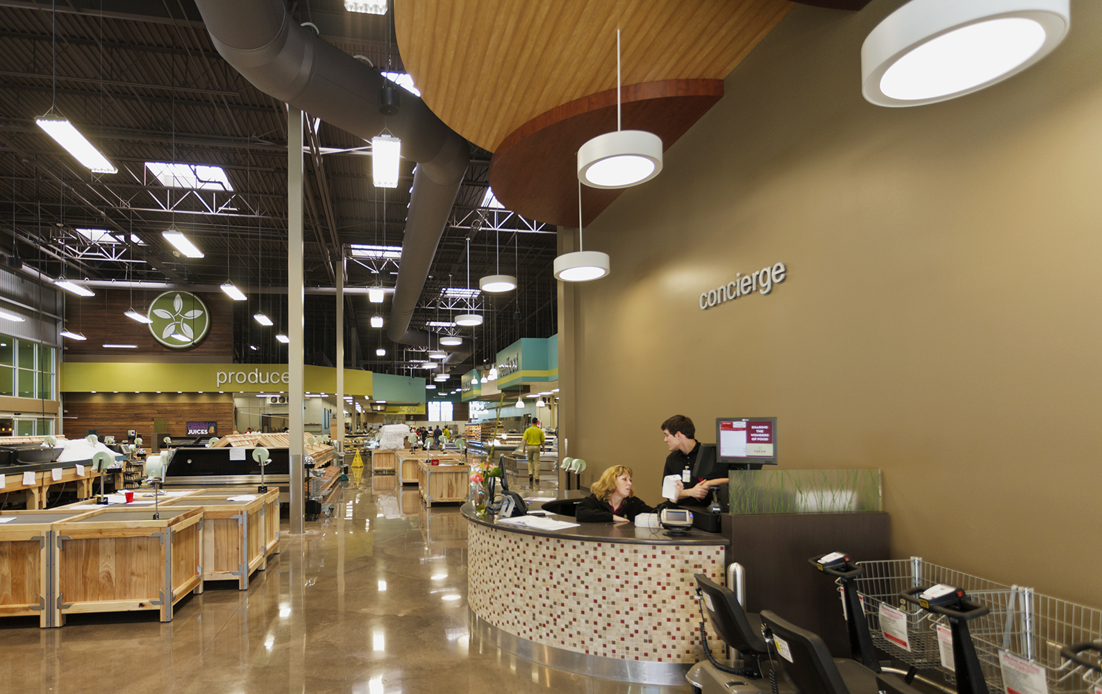 Omnience fixtures are good for retail lighting designs, seen here above a checkout area in a modern grocery store.