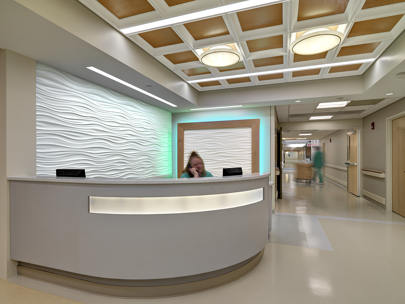 Ovation in a sleek, modern healthcare design application, mounted above a nurse's station.