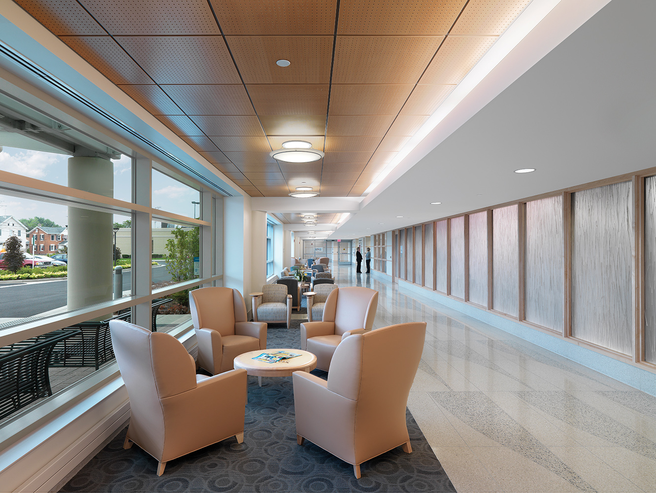 Ovation ceiling-mounted luminaires in a hospital lighting application along a waiting area.