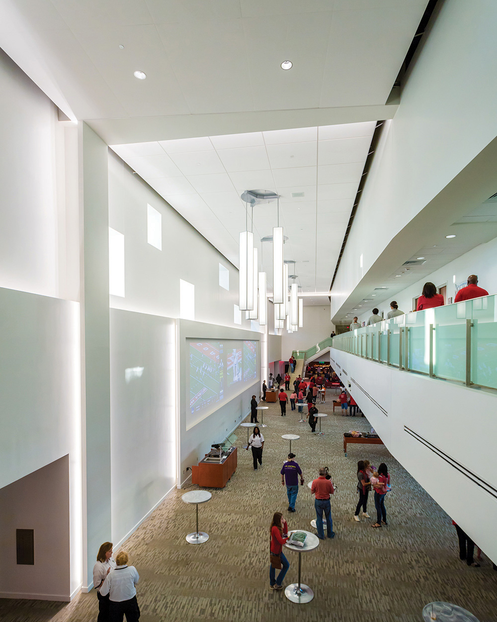 Parallel pendants in an education lighting application, mounted above a large campus sports arena lobby.