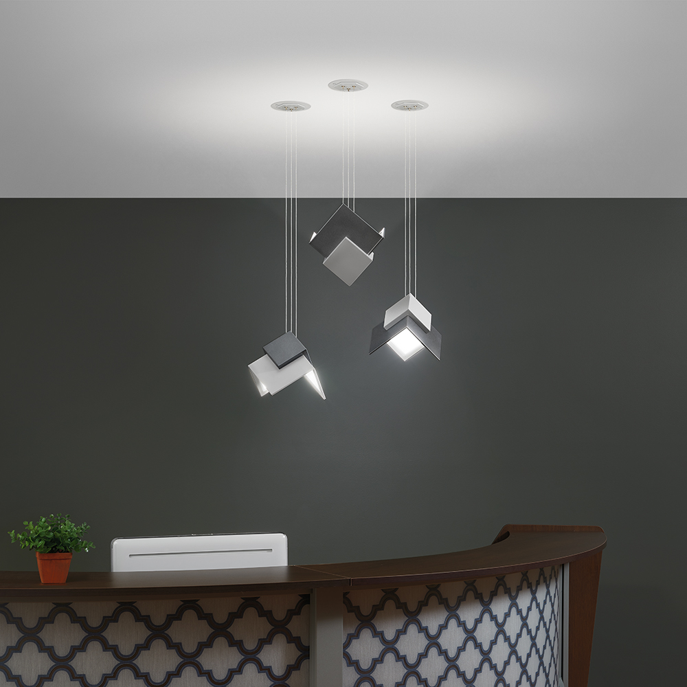 Petal OLED pendants make beautiful hospital lighting features above this sophisticated reception desk.