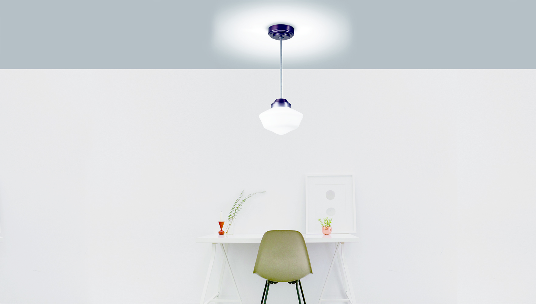 School Haus pendant in hospitality lighting design above a small desk area.