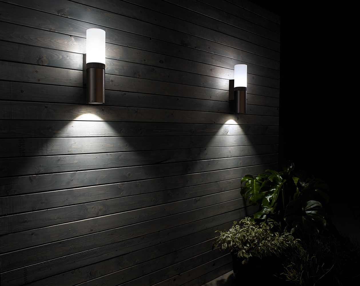 Scope exterior luminaires illuminate an outdoor apartment lighting design with soft diffused light and attractive downlight.