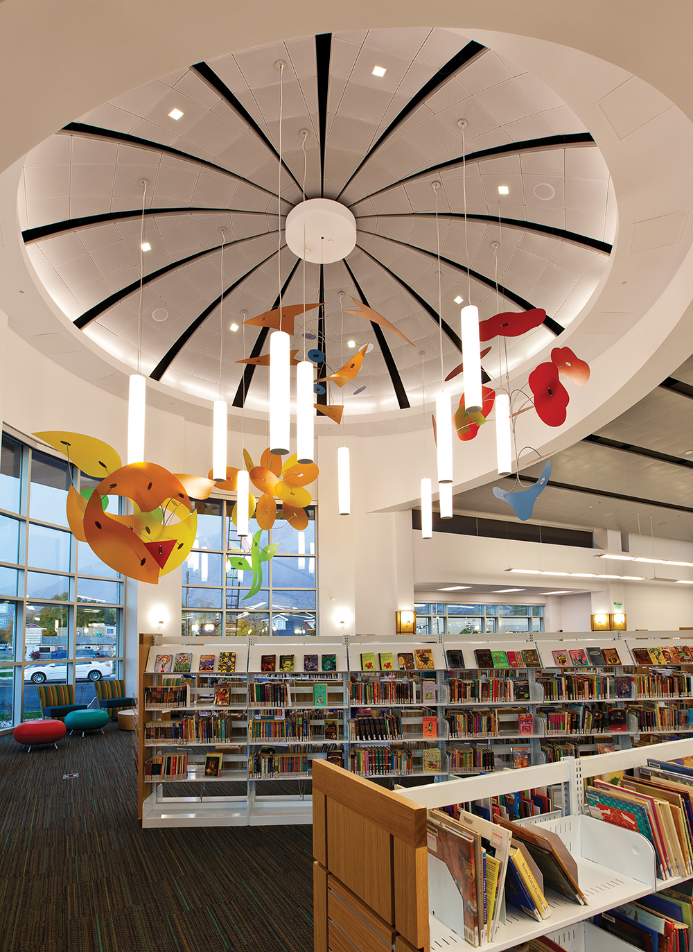 Sequence pendants in a circular configuration for a stylish central feature in a library lighting design.