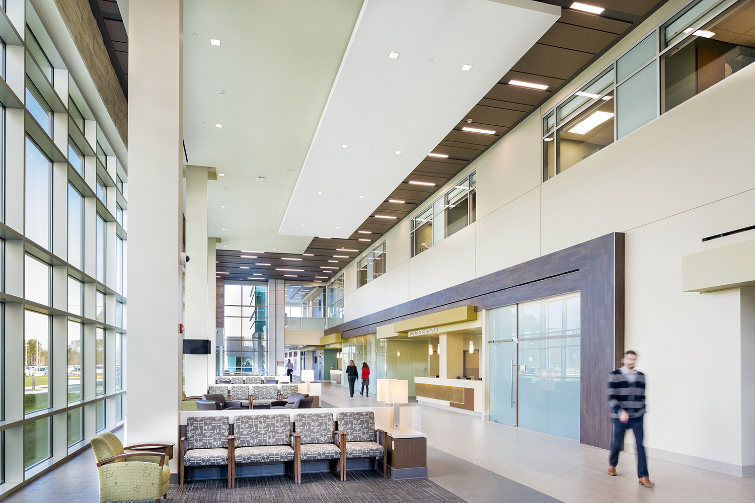 Serenity table lamps provide comforting healthcare design in a large waiting area and hospital corridor.