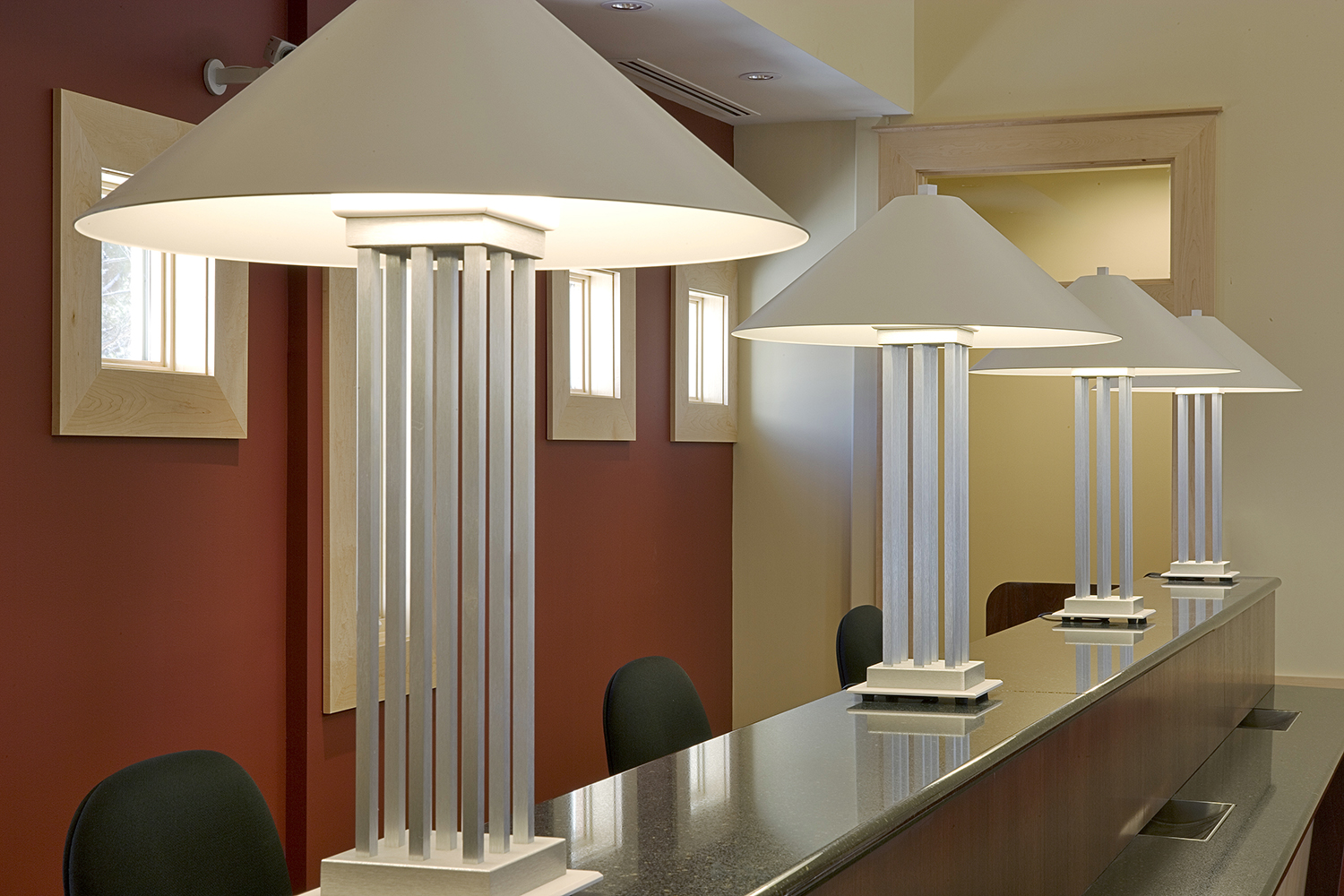 South Bay portable lamps provide distinguished architectural lighting on a reception counter.