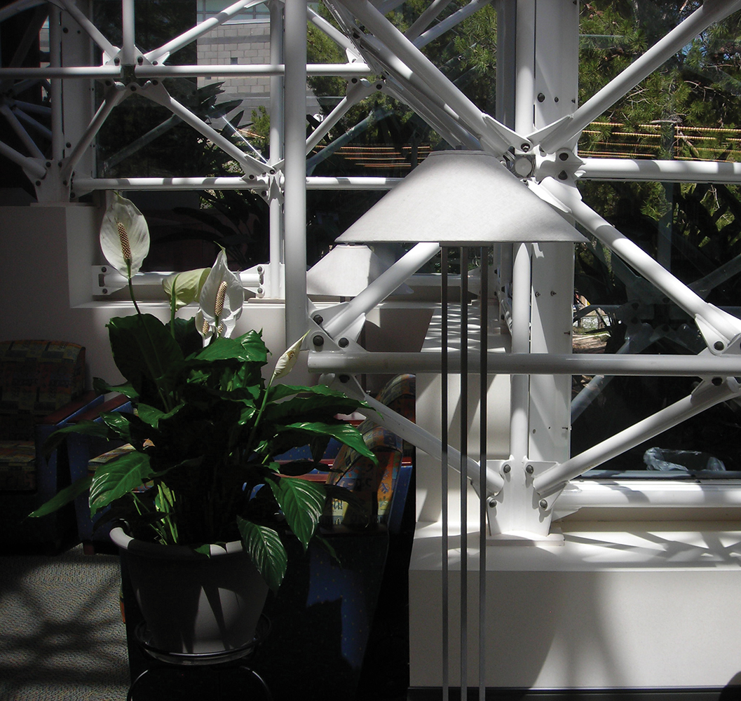 South Bay architectural lighting fixture as a portable floor lamp in a waiting area with industrial windows and natural light.