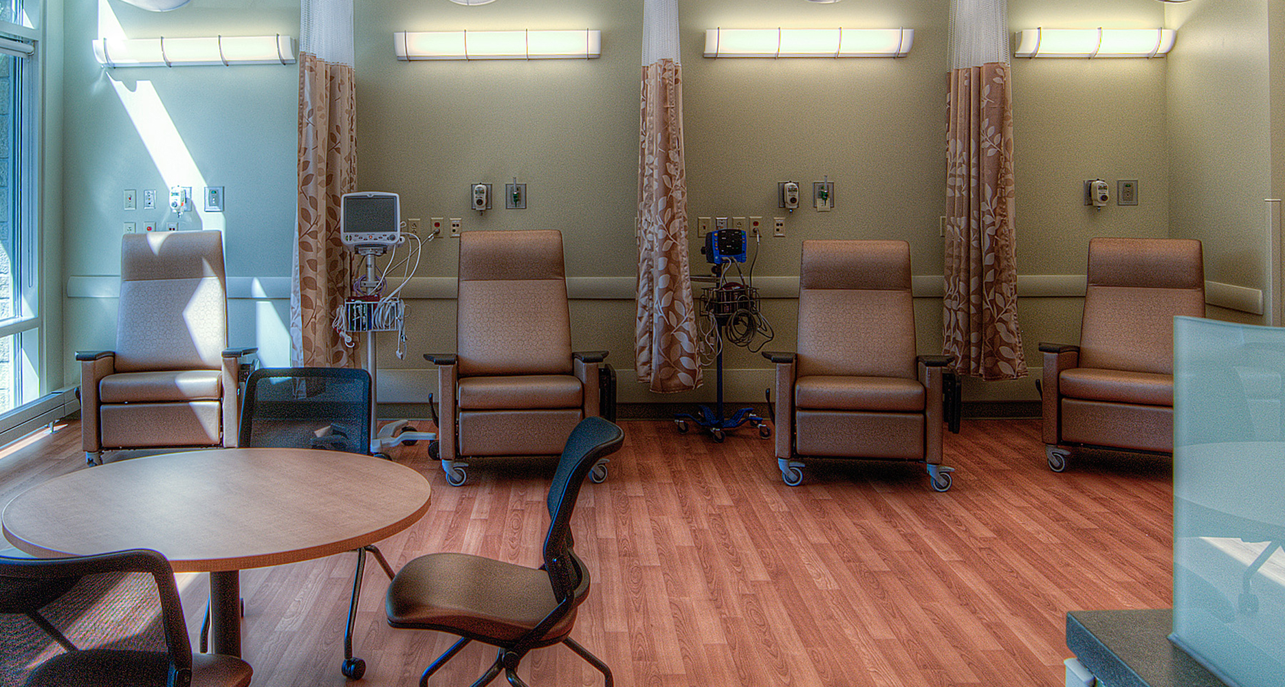 Tusk wall fixtures in a medical lighting designilluminatepatient infusion seating area