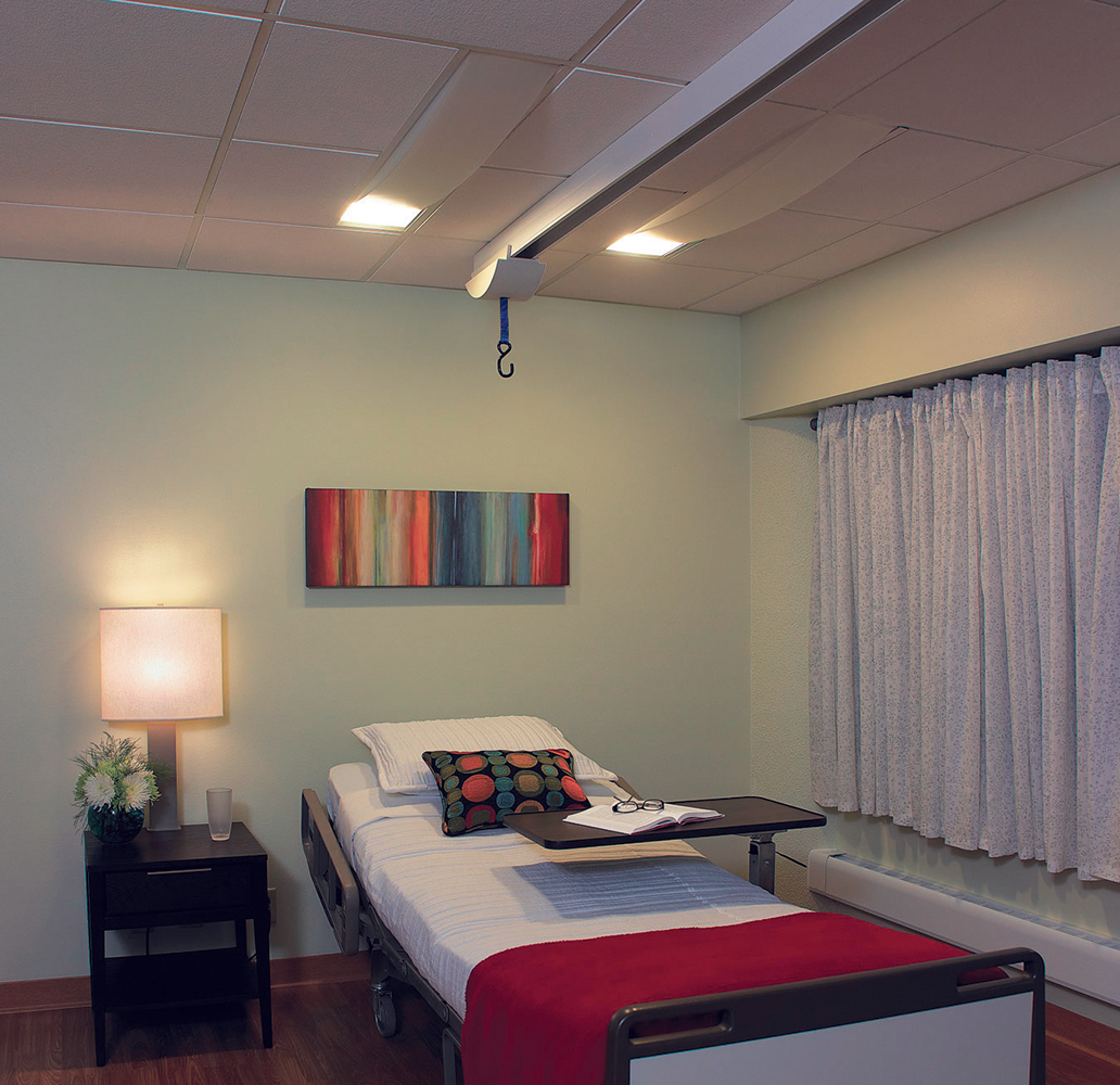 Unity medical lighting in table lamp and overbed luminaires in exam mode over a patient bed.