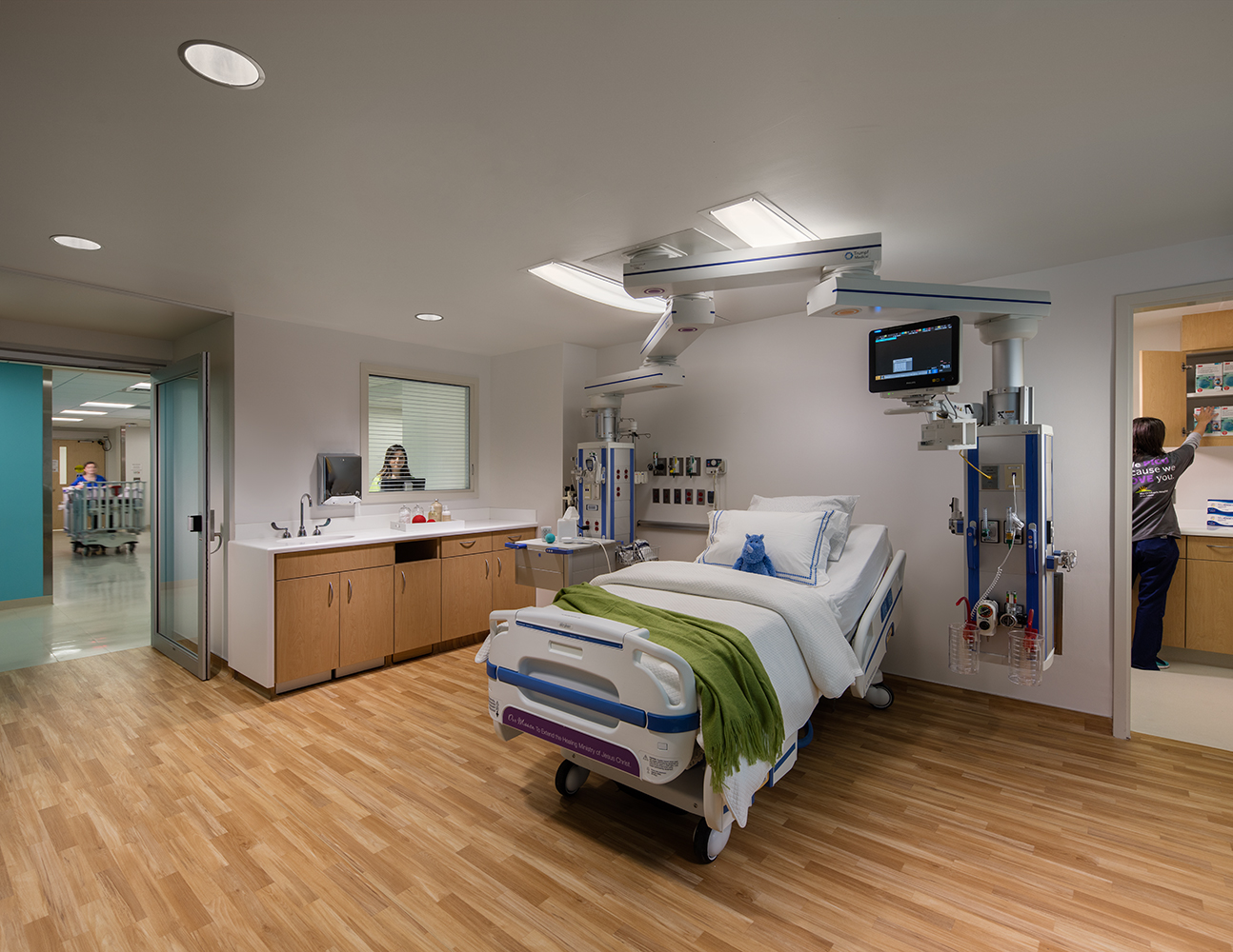 Unity tandem overbed luminaires allow for attractive patient room lighting without obstructing medical equipment.
