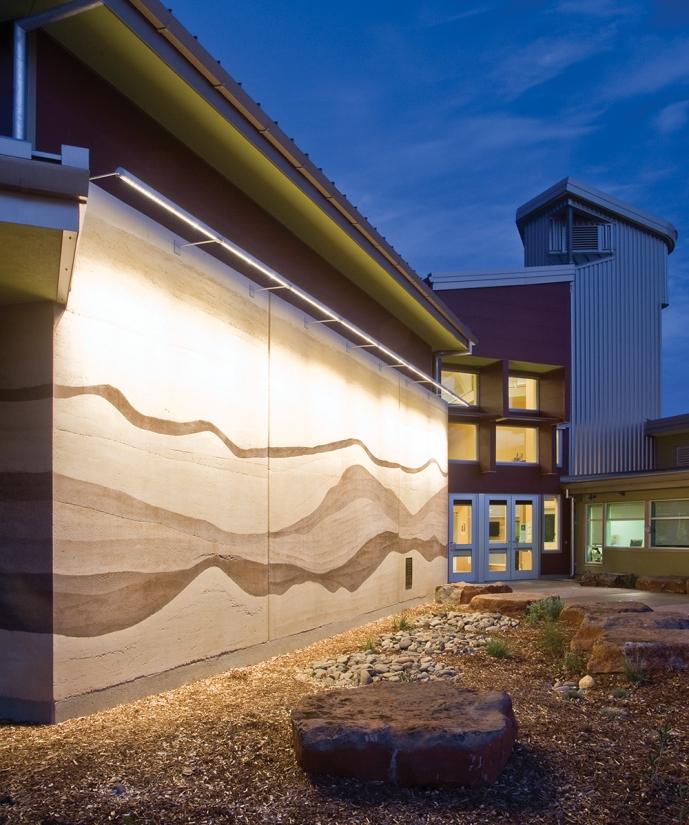 Advantus outdoor light fixtures illuminate an exterior wall along its upper edge, without revealing the light source.