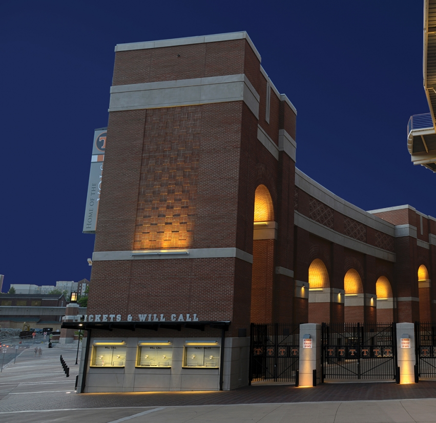 Advantus linear outdoor light fixtures illuminate a brick ticket area for a college stadium at night.