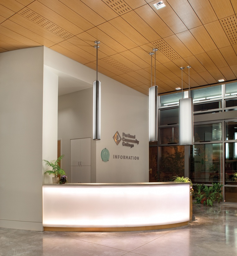 Air Foil education lighting fixtures hung above a college reception area.