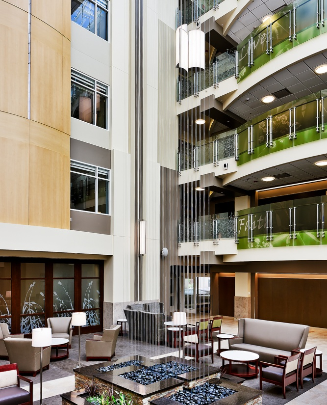 Air Foil large venue fixtures float above a healthcare design lobby to light up multiple floors.