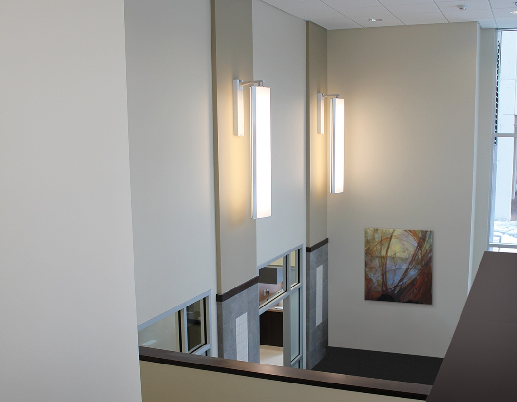 Air Foil pendants can complement healthcare design in lobbies, shown here as a sconce above doorways.
