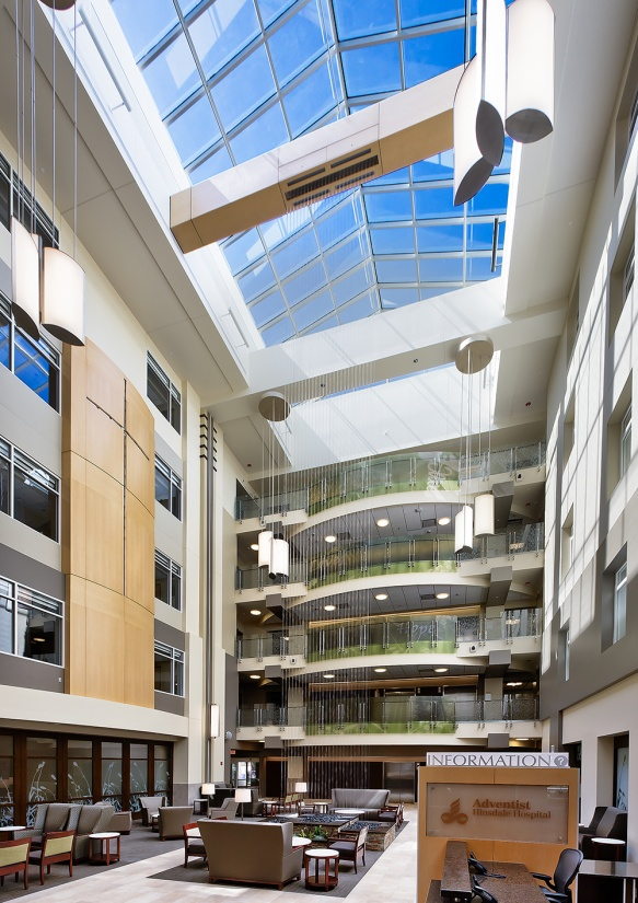 Air Foil pendants in a hospital lighting its large atrium with clean, diffused light.