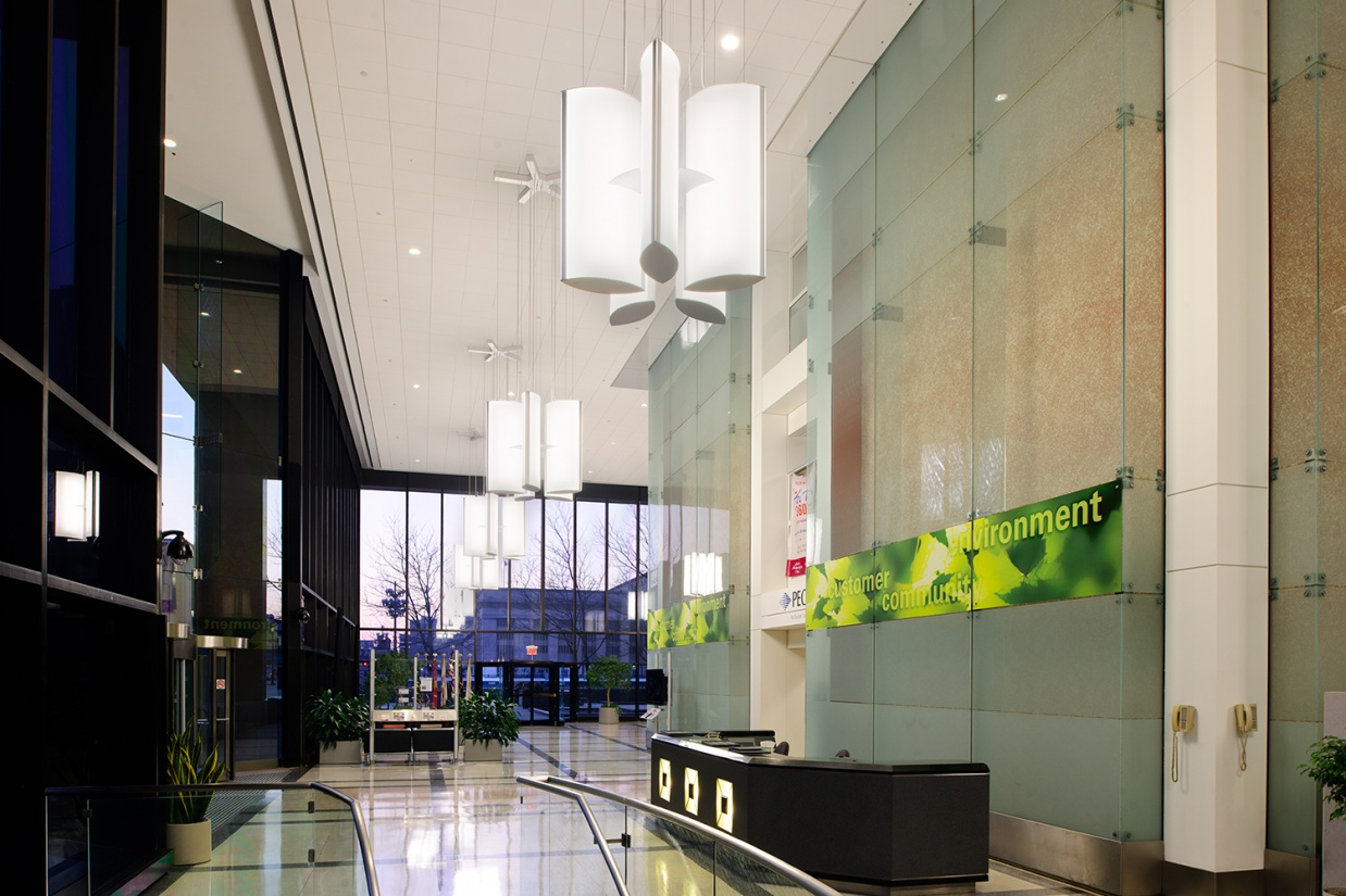 Air Foil pendants in a distinct lobby lighting design, grouped together in flower shapes.