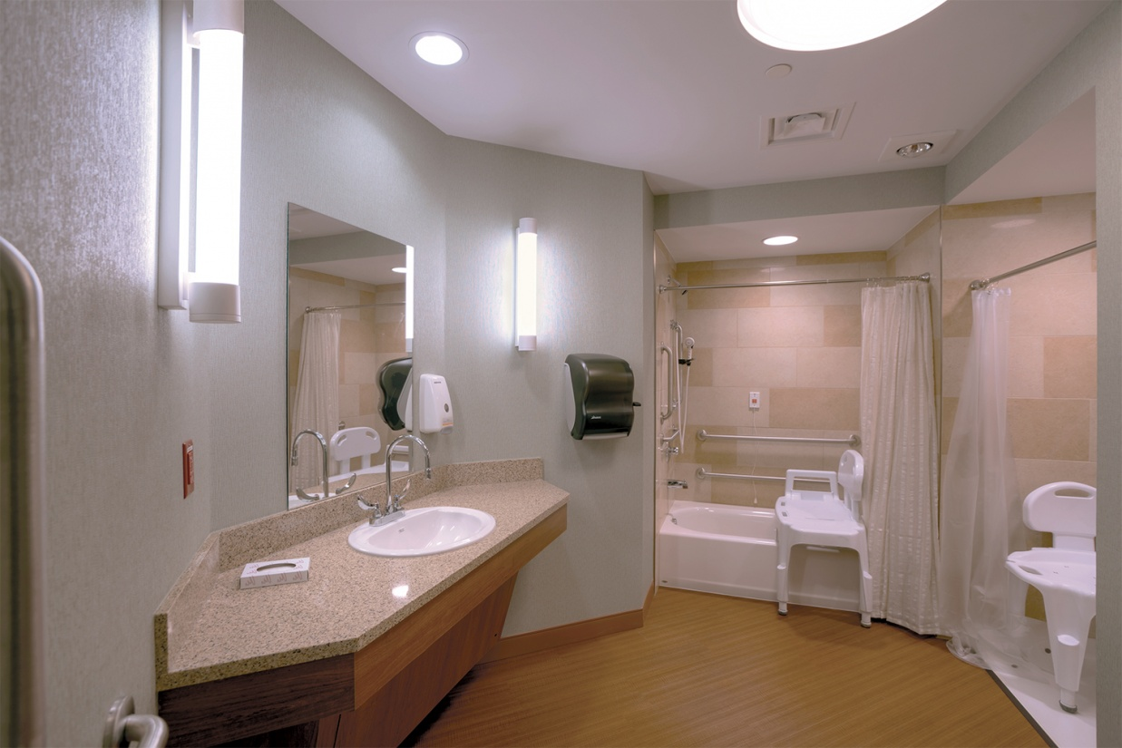 Asta modern vanity light fixtures provide accurate, stylish light for a nursing center bathroom.