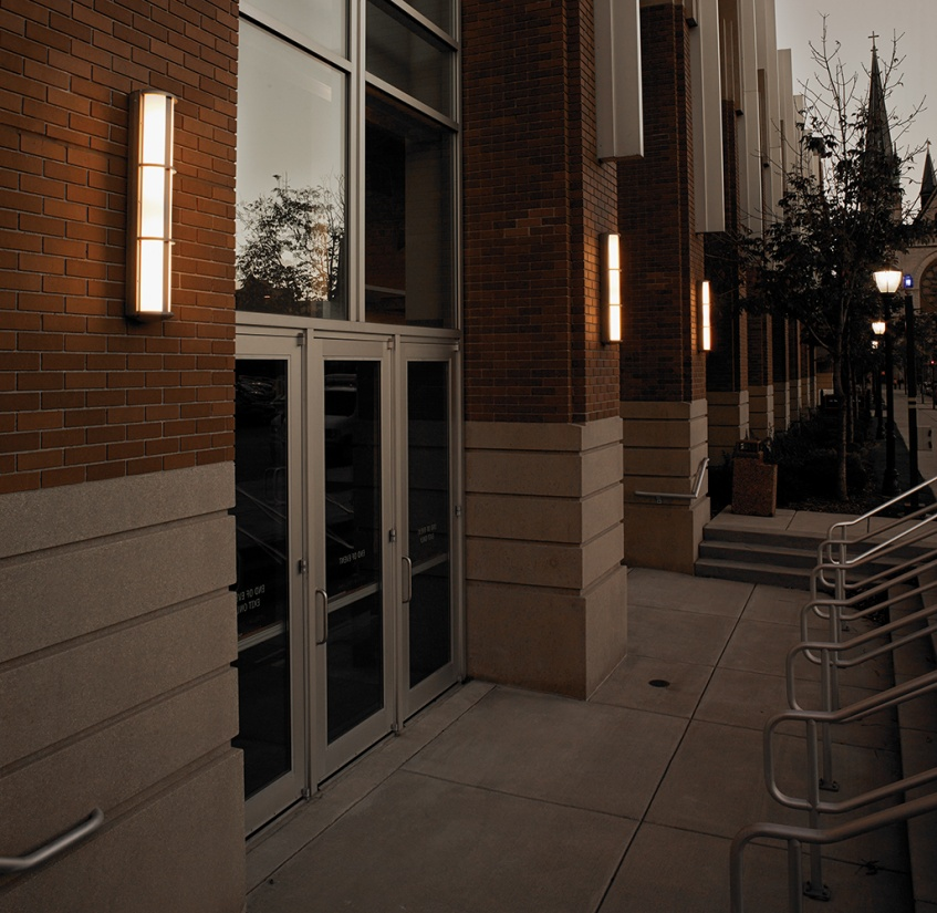 Avatar exterior lighting fixtures illuminate a campus library doorway with a classic, sophisticated aesthetic.