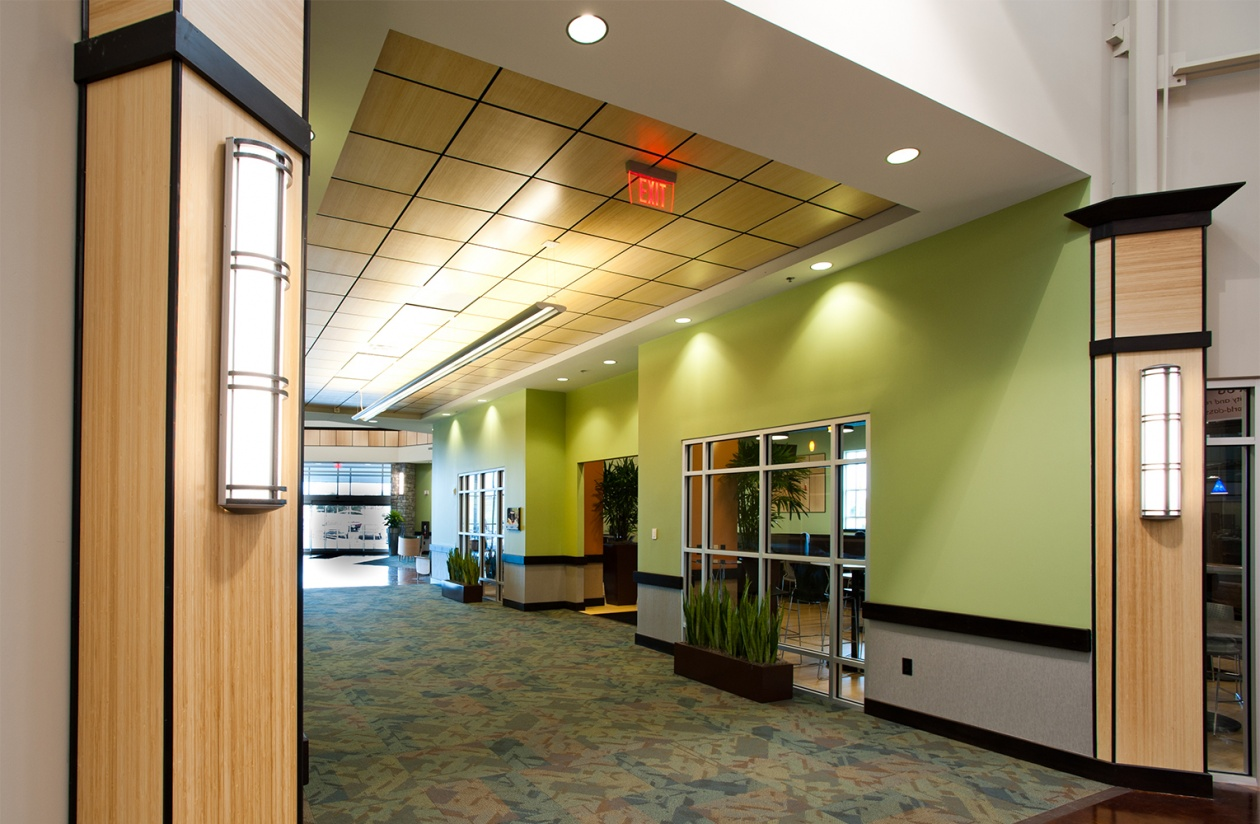 Avatar indoor wall sconces with bar accents are shown here in a modern hospital lighting design.