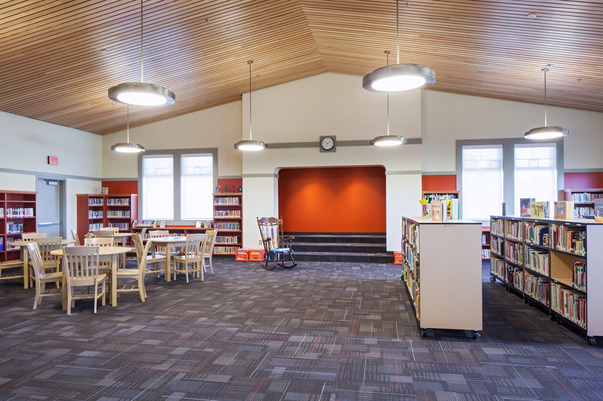 Broadway pendants are perfect for classroom lighting, seen here above a modern school library.