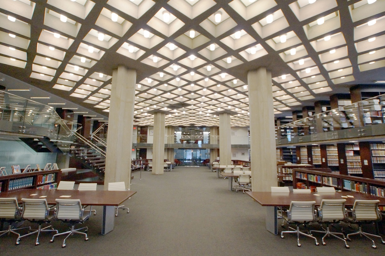 Cane cylinder ceiling luminaires in education lighting design, seen here mounted in recessed square cutouts above a campus library.