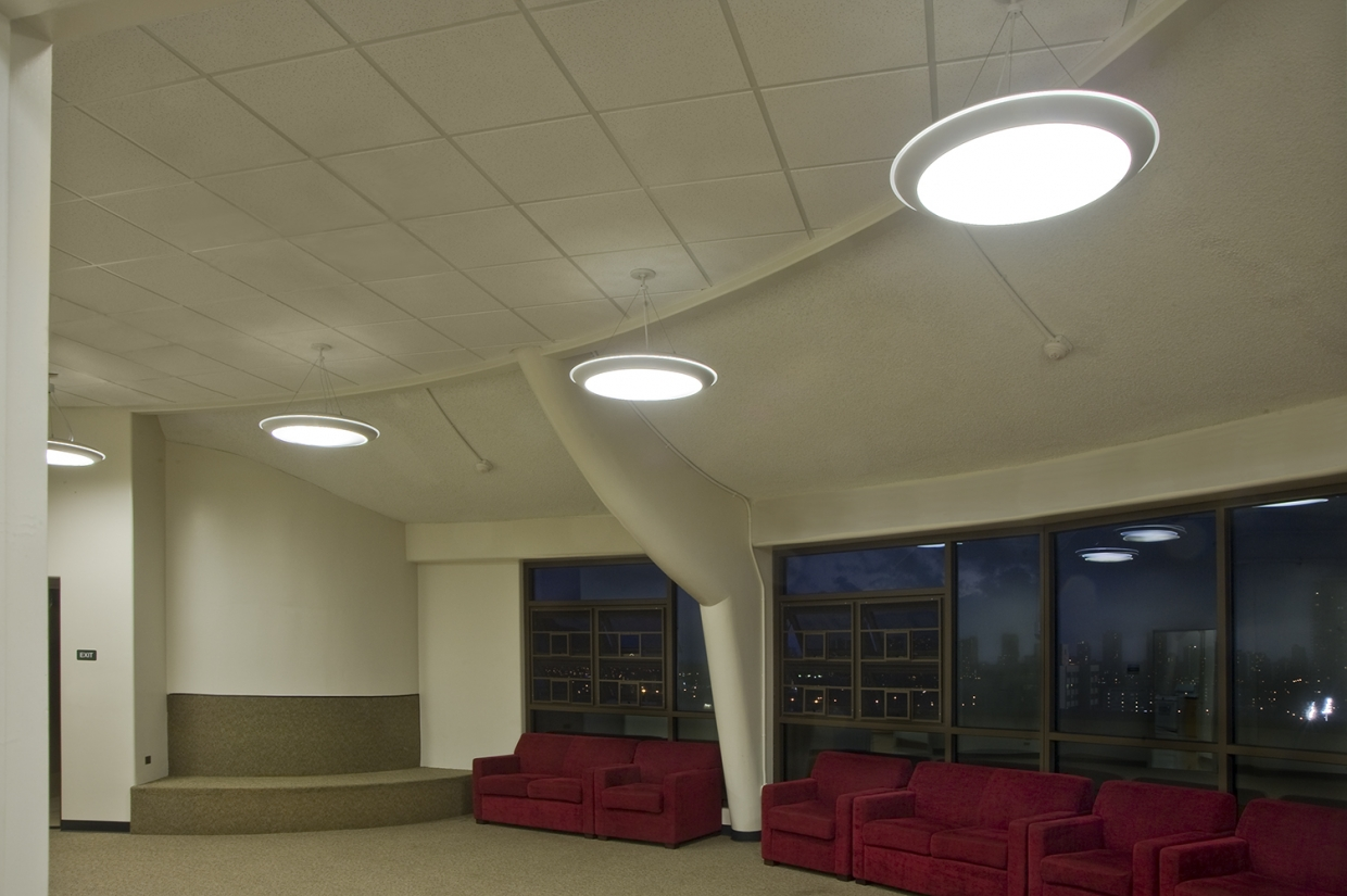 Capience pendants provide eye-catching illumination for educational interior design inside a dormitory hallway.