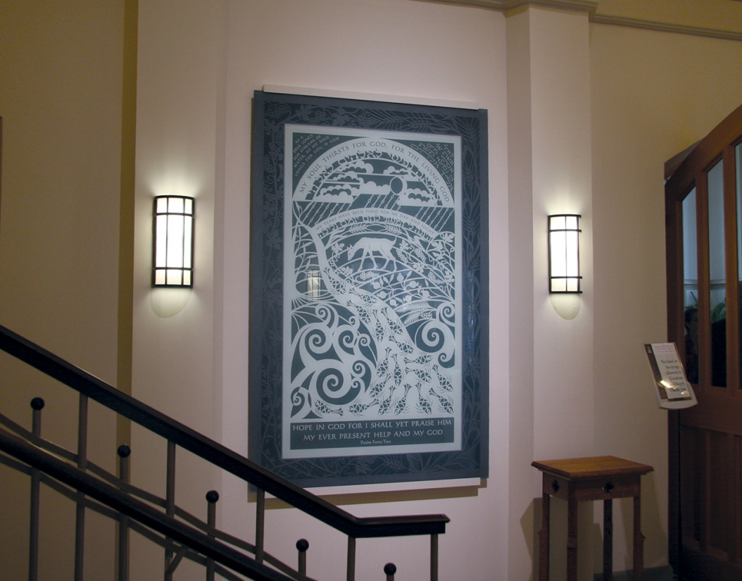 Colonnade wall sconces in an education lighting application alongside campus hallway artwork