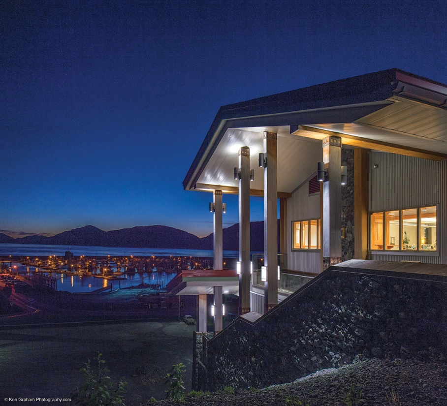Colonnade and Scope exterior lighting fixtures illuminate a waterfront building with clean, modern light.