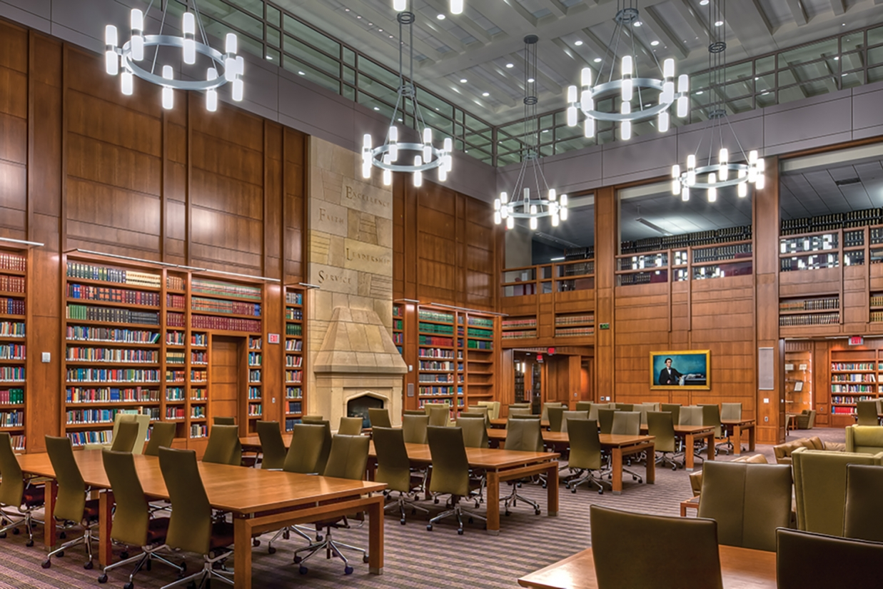 This law school library combines classic materials with modern custom light fixtures with rings of cylinders.